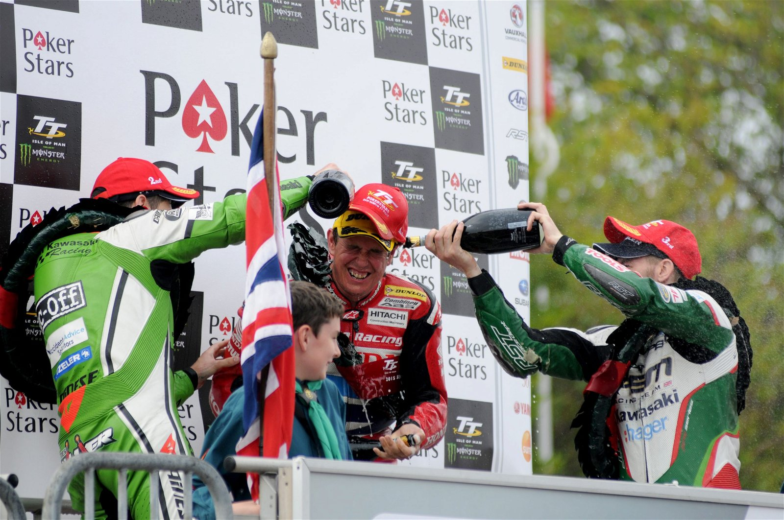 John McGuinness getting doused in champagne on the podium