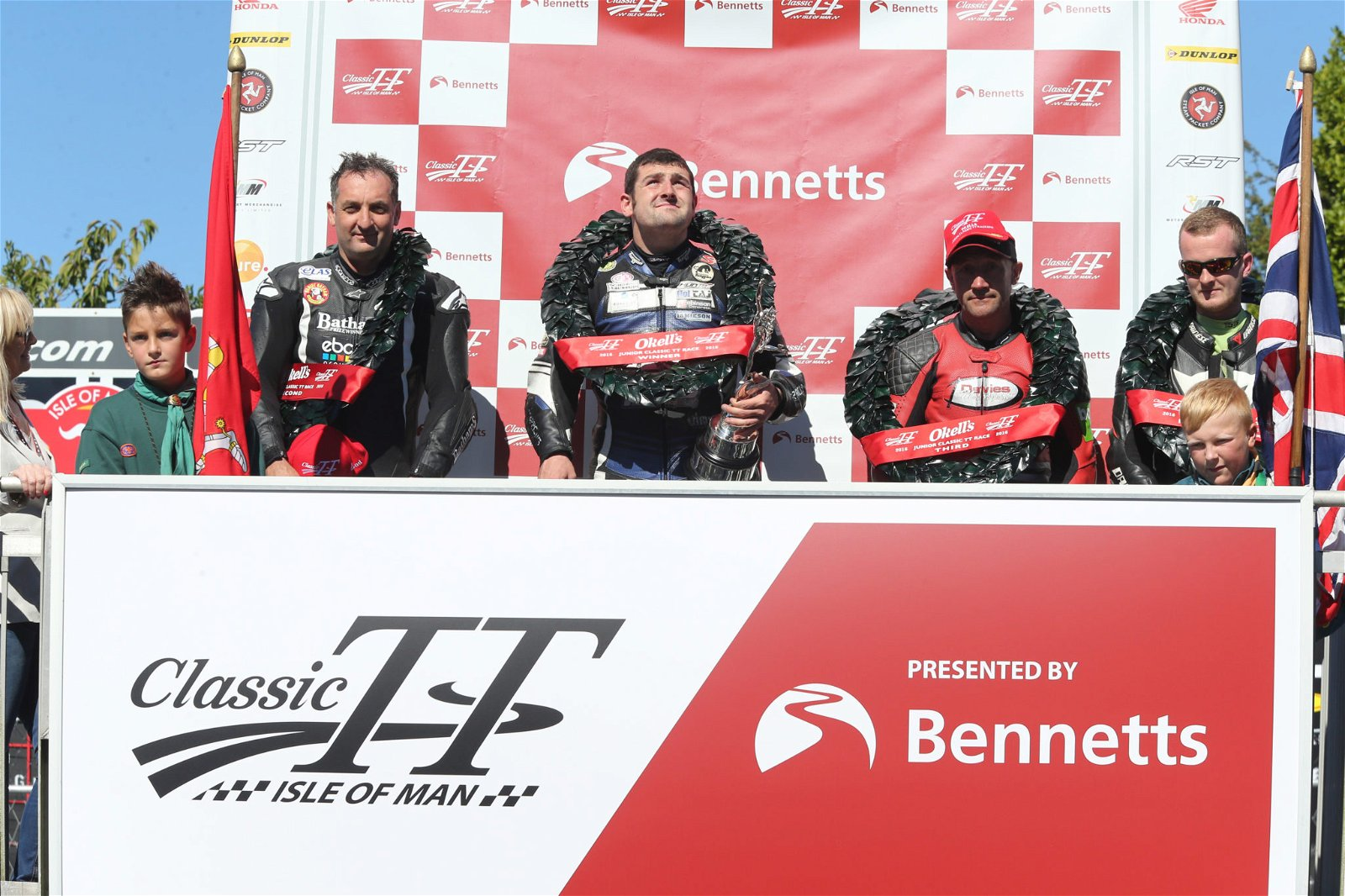 PACEMAKER, BELFAST, 29/8/2016: Michael Dunlop (Black Eagle MV Agusta) celebrates winning the 350cc race at the Classic TT today with runner up Michael Rutter and third placed Alan Oversby. PICTURE BY STEPHEN DAVISON
