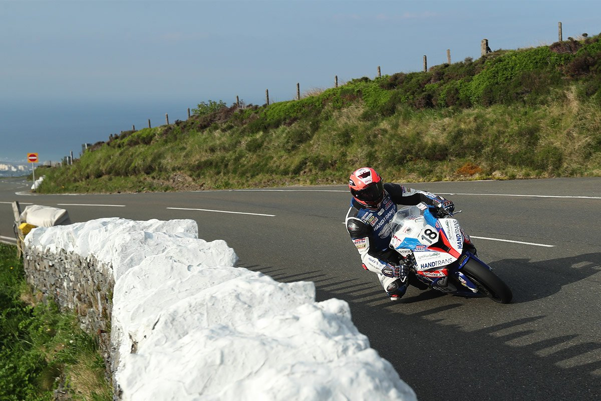 Phil Crowe getting his knee down at the 2018 TT