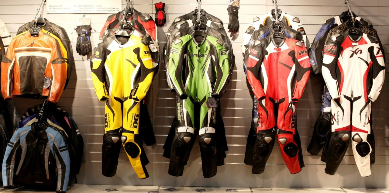 Motorcycle leathers hanging in shop